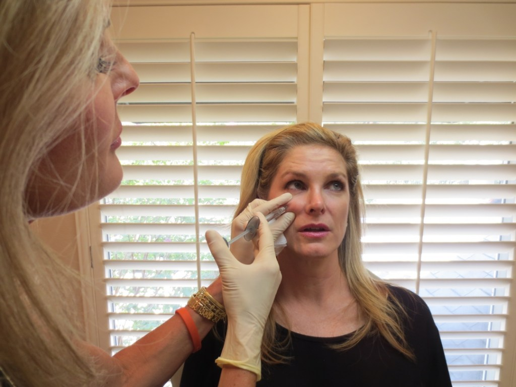 Dr. Lynley McAnalley injecting Juvederm Voluma
