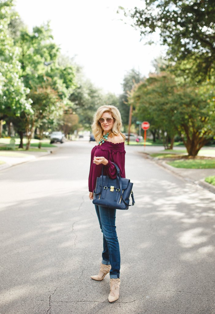 The currant Max Studio top and skinny jeans are paired with this Phillip Lim bag.