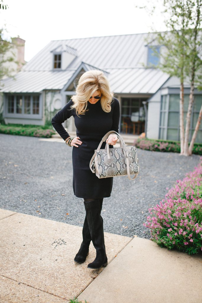 Black cashmere sweater dress with black over the knee boots and a python bag on TanyaFoster.com