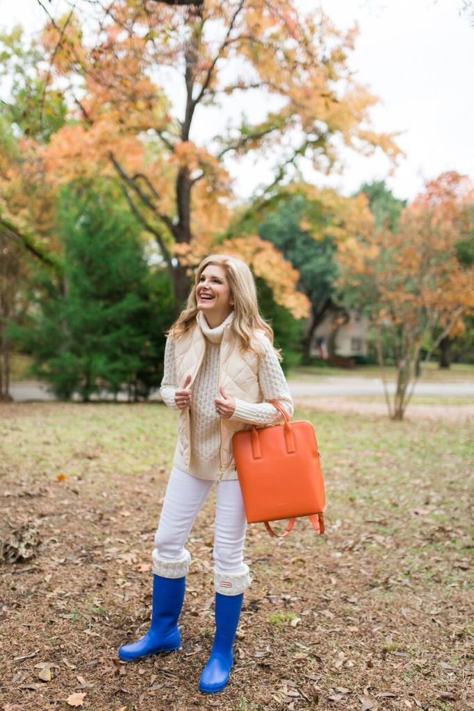 All white J. Crew outfit with blue Hunter boots and an orange Sarah White backpack.