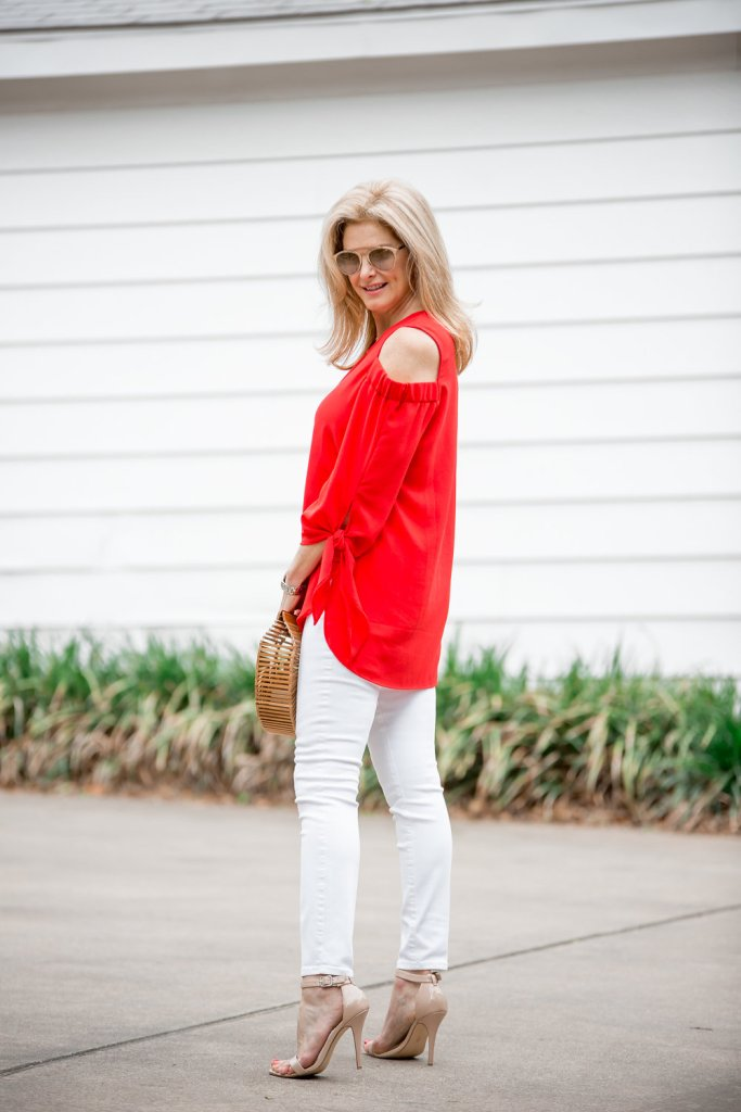 Combining a red top, white jeans and the Cult Gaia bag for a spring look.
