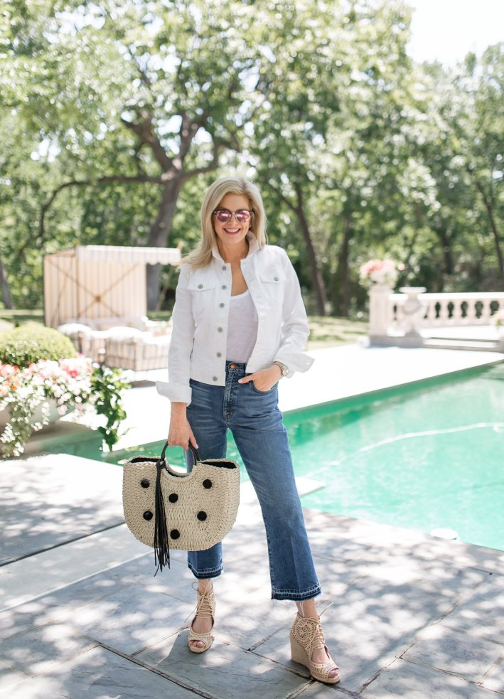 Tanya Foster wears high waisted denim from Nordstrom with white t-shirt and white jean jacket.