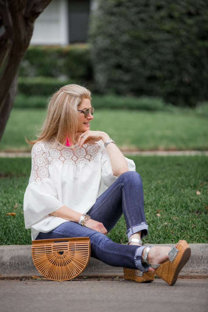 White floral crochet top from Chicwish with jeans and Cult Gaia bag