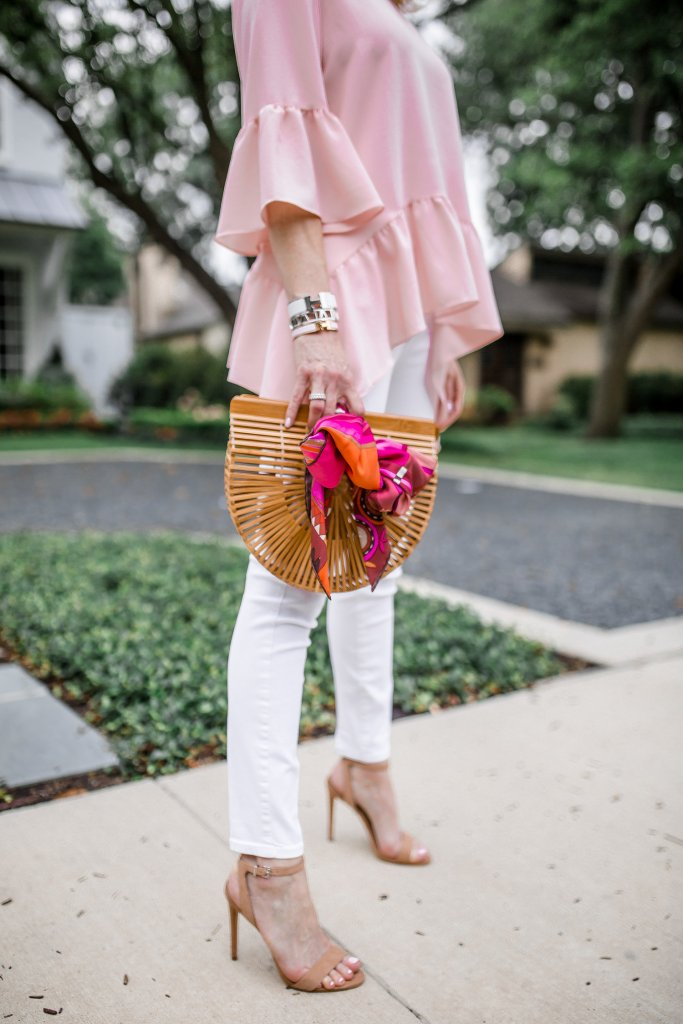 Gibson ruffled hem shirt with white jeans and Cult Gaia Ark bag