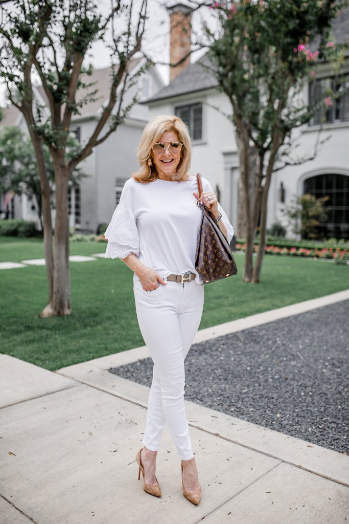 How to Restore your Christian Louboutin Shoes in 3 Easy Steps featured by top US fashion blogger, Tanya Foster: image of a woman wearing Christian Louboutin red soles.