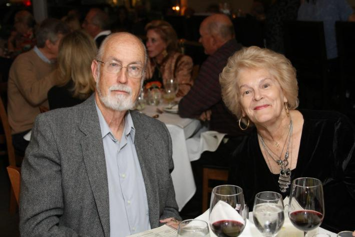 Tips on How to Move Forward After Losing a Parent by popular life and style blogger, Tanya Foster: image of an elderly couple sitting together at a table in a crowded restaurant.