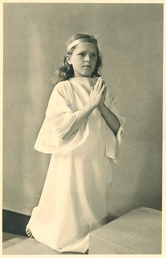 Tips on How to Move Forward After Losing a Parent by popular life and style blogger, Tanya Foster: black and white image of a little girl dressed in an angel costume.
