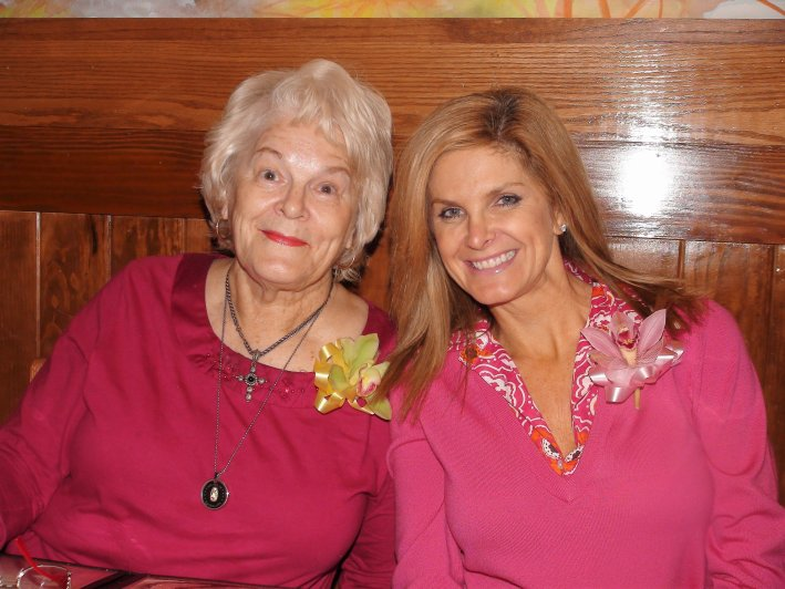 Tips on How to Move Forward After Losing a Parent by popular life and style blogger, Tanya Foster: image of a woman and her mother sitting next to each other and wearing pink shirts.