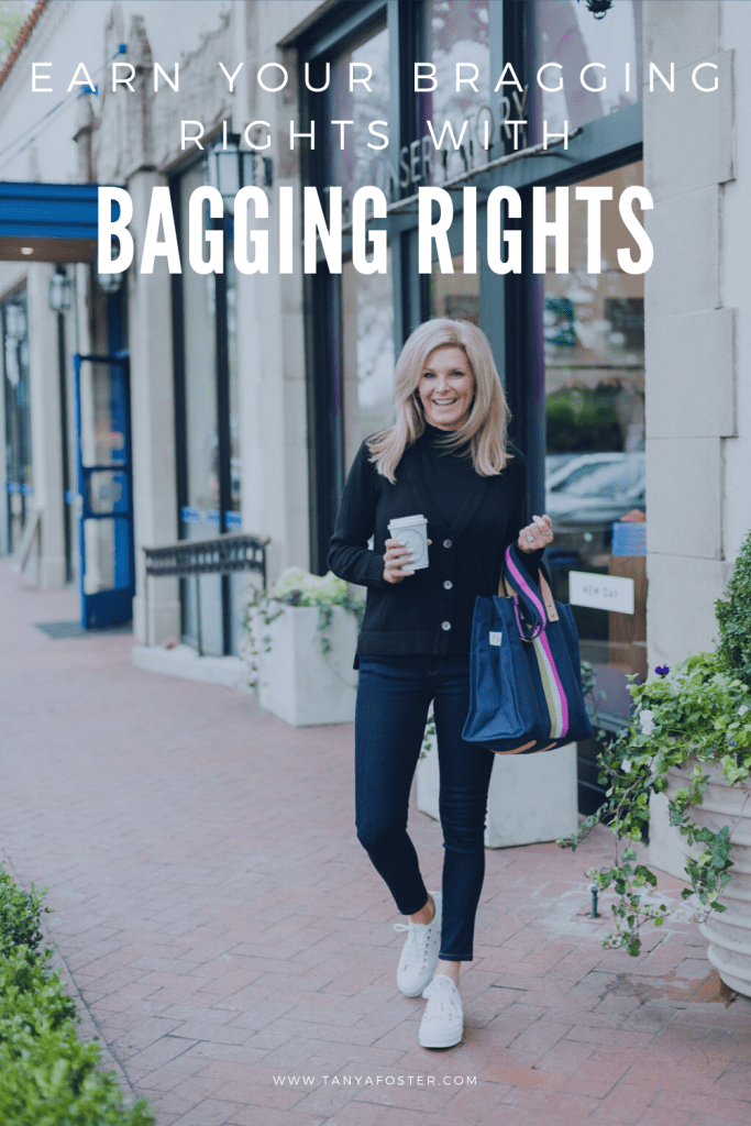 Tanya Foster with bagging rights tote bag and wearing a black chico's cardigan with mott & bow jeans