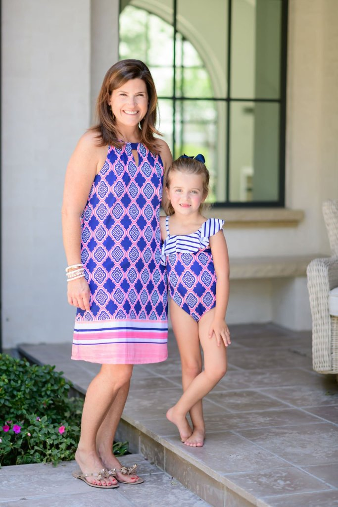 mom and daughter in matching cabana life dress and swimsuit