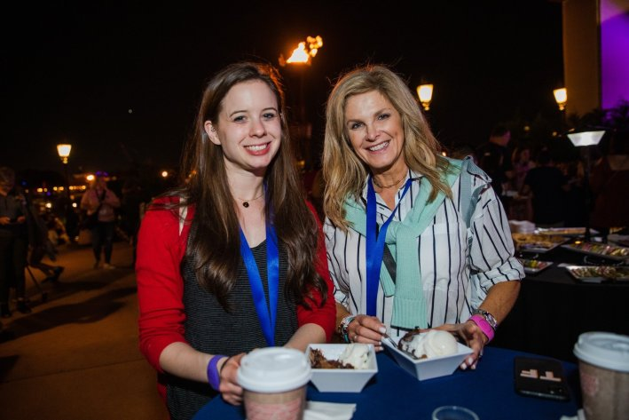 Tanya Foster and assistant eating dessert at disney creators celebration