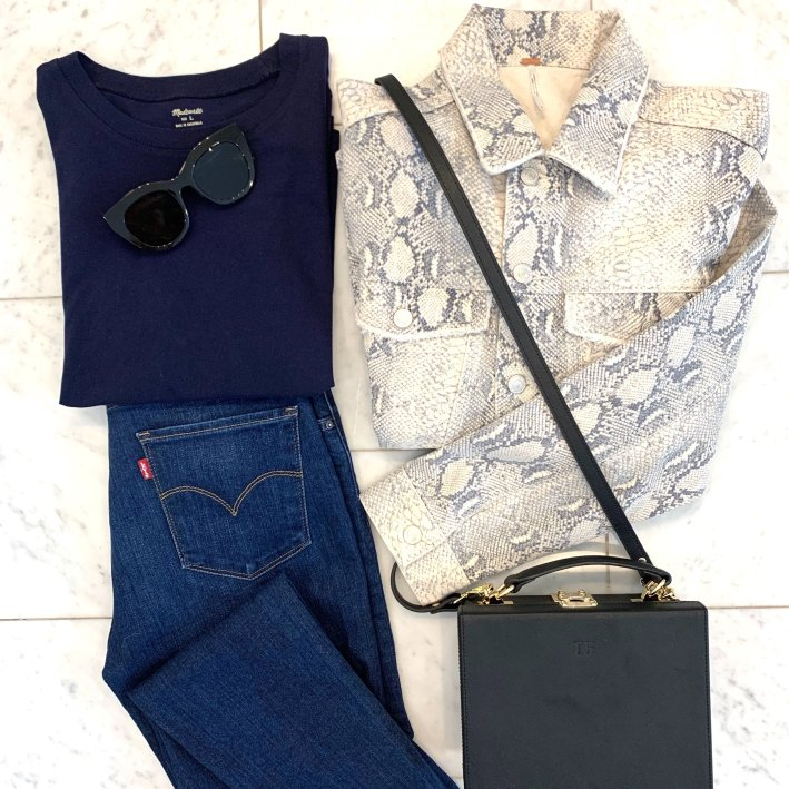 Snakeskin print denim jacket, blue tee, Levi's jeans and tde. crossbody bag