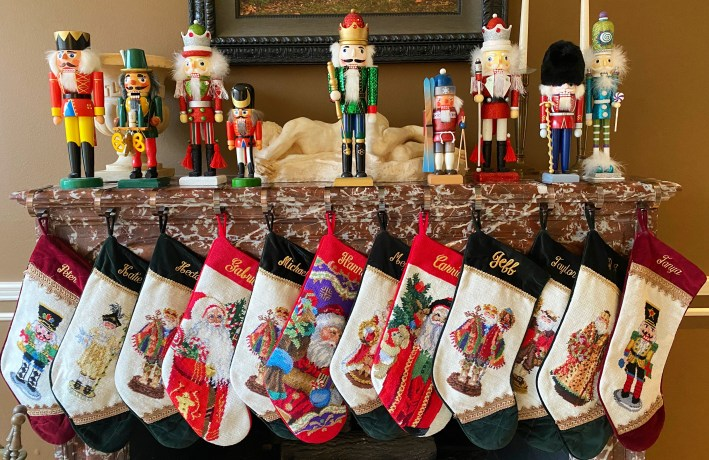 Nutcrackers and Christmas stockings on the fireplace mantel