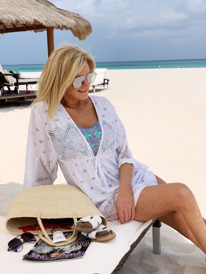 Tanya foster lounging at the beach in cabana life swimwear