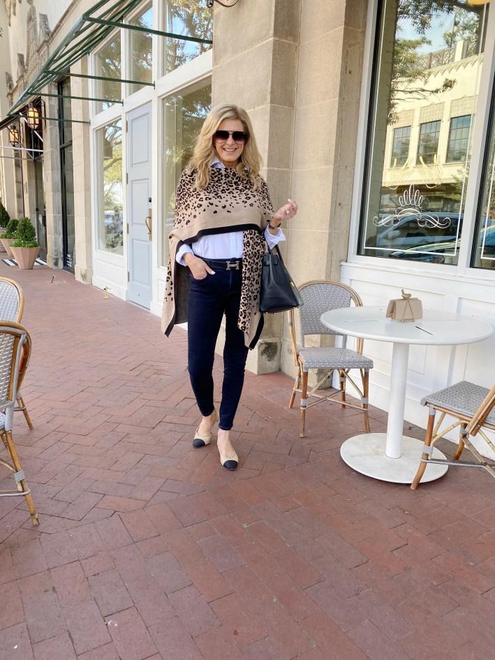 Tanya Foster walking on a sidewalk