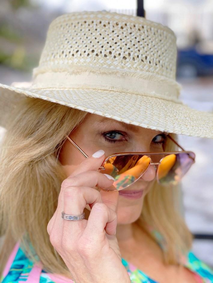Tanya Foster peering over her sunglasses