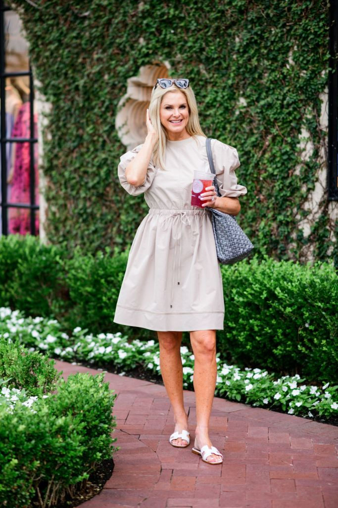 Tanya foster wearing beige dress with barrington tote and tuckernuck sunglasses