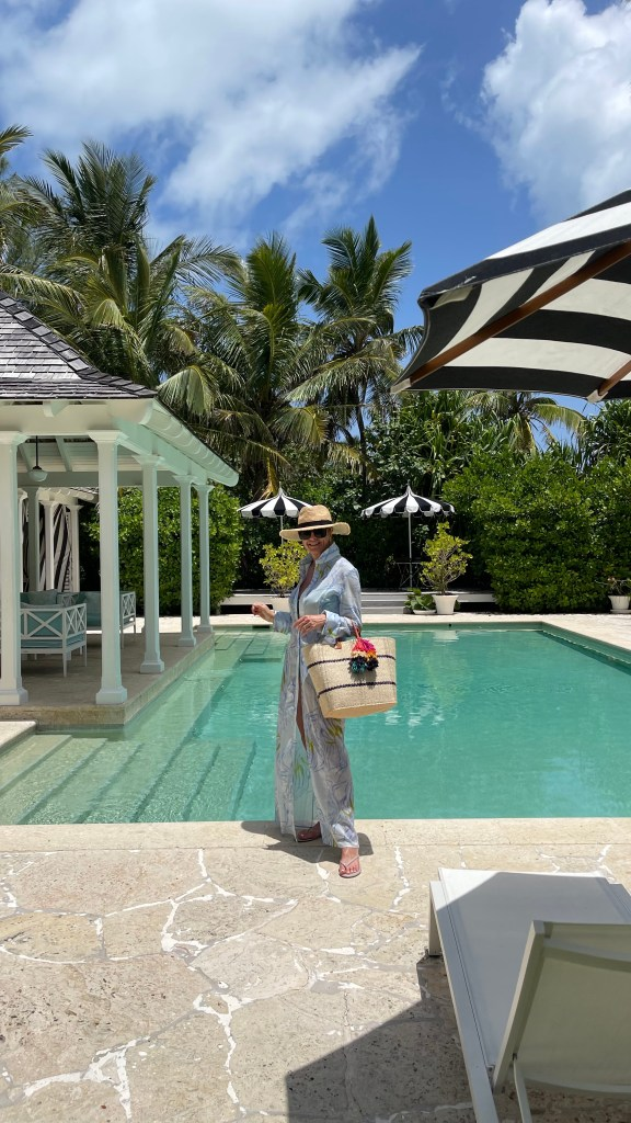 Tanya foster wearing ala von auersperg tunic over a swimsuit and straw tote bag