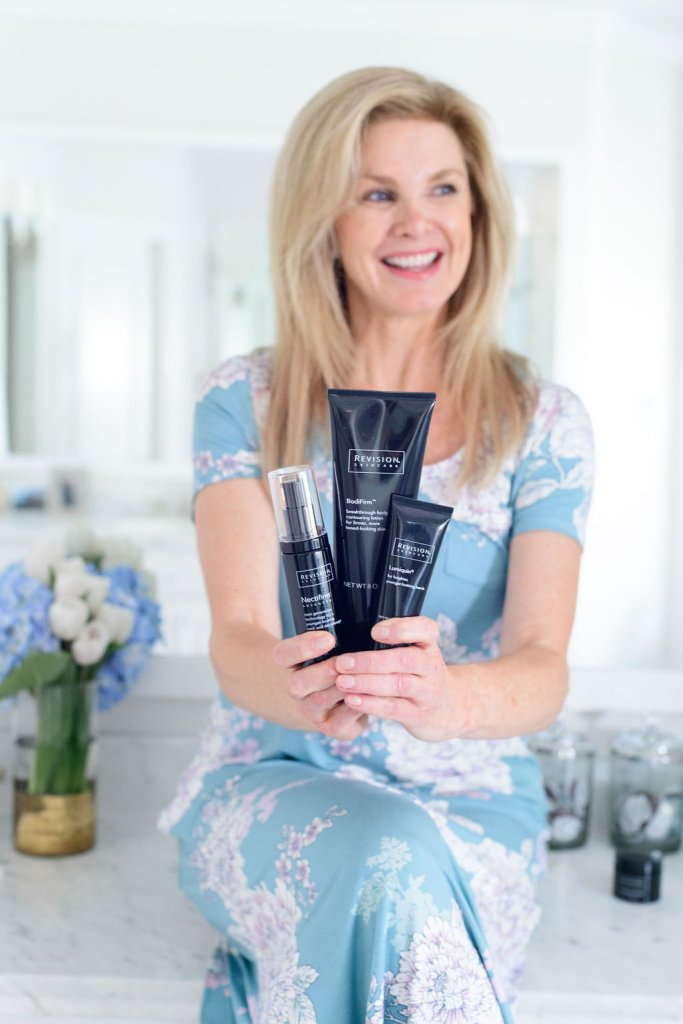 Tanya Foster holding revision skincare bodifirm nectifirm and lumiquin products