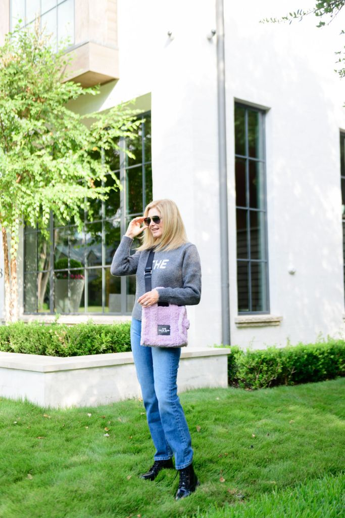 Tanya Foster wearing Marc Jacobs sweater and jeans with marc jacobs bag and sunglasses