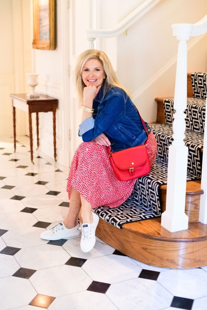 Tanya Foster in talbots red leopard tie waist midi dress and denim jacket with sperrys and red crossbody purse