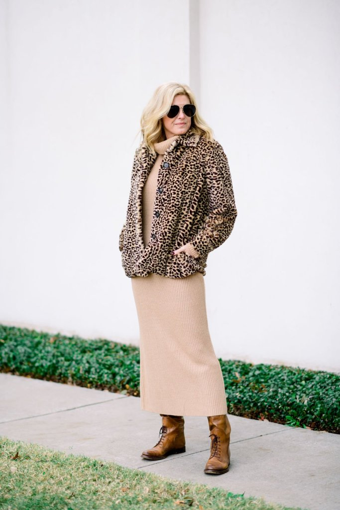 tanya foster in a camel sweater dress and animal print faux fur coat with boots