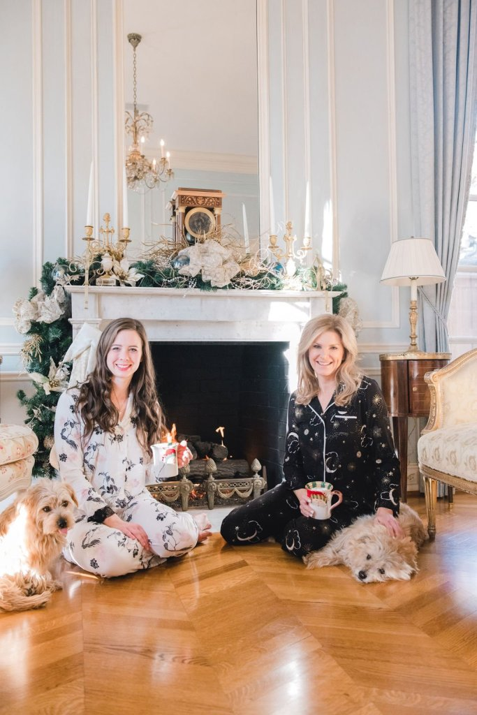 Tanya Foster and assistant sitting in front of a fireplace discussing After Christmas Sales