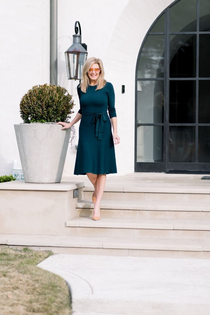 Tanya Foster walking down steps in an Eliza J sweater dress