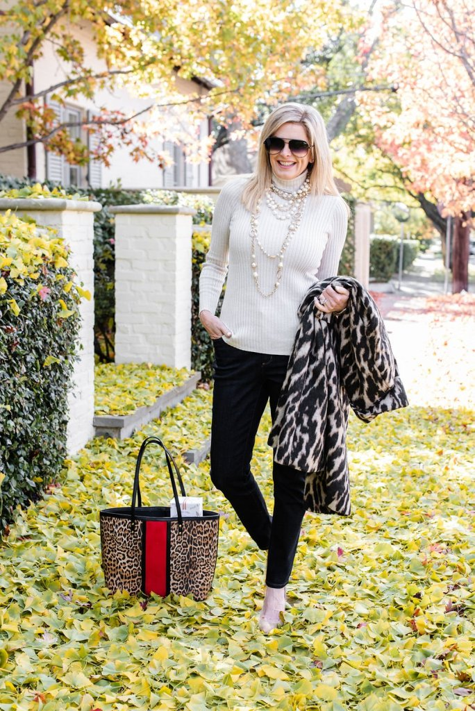 Tanya Foster wearing Chico's for the 2019 holidays with animal print tote bag