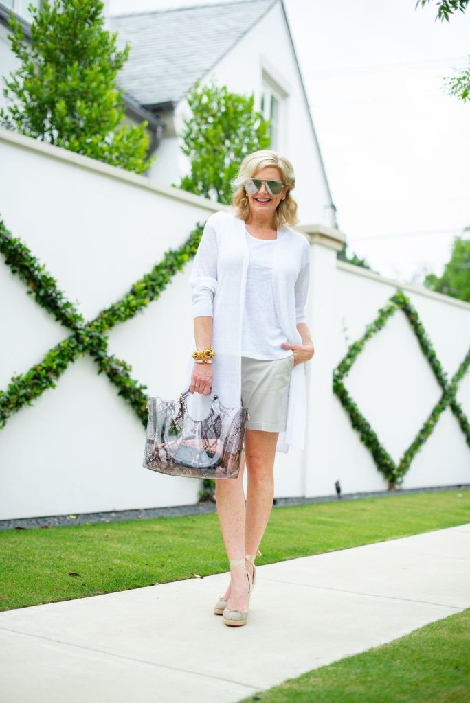 How to style flattering shorts, styling tips featured by top US fashion blogger, Tanya Foster: image of a woman wearing a Vince Camuto weekend tote, Quay Australia aviator sunglasses, Julie Vos Valencia bracelet, Talbots chino shorts, Talbots linen tee, and Soludos espadrille sandals