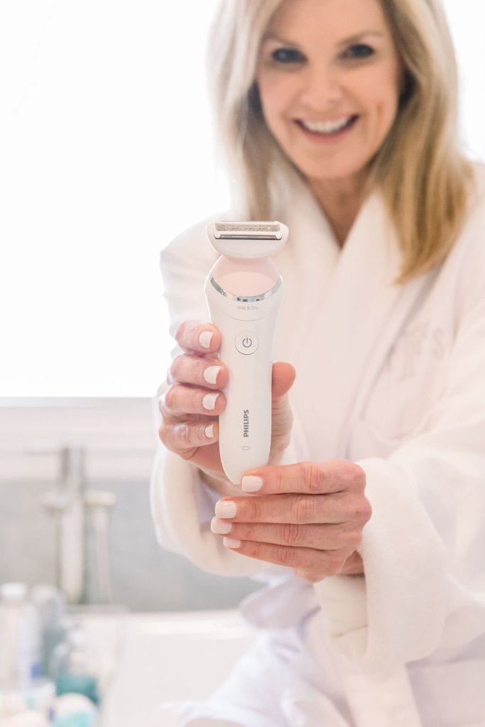 Tanya Foster holding Philips SatinShave electric shaver
