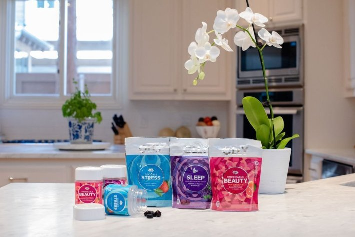 Why I love my Olly Vitamins! by popular life and style blogger, Tanya Foster: image of various types of Olly Vitamins next to each other on a kitchen counter top.