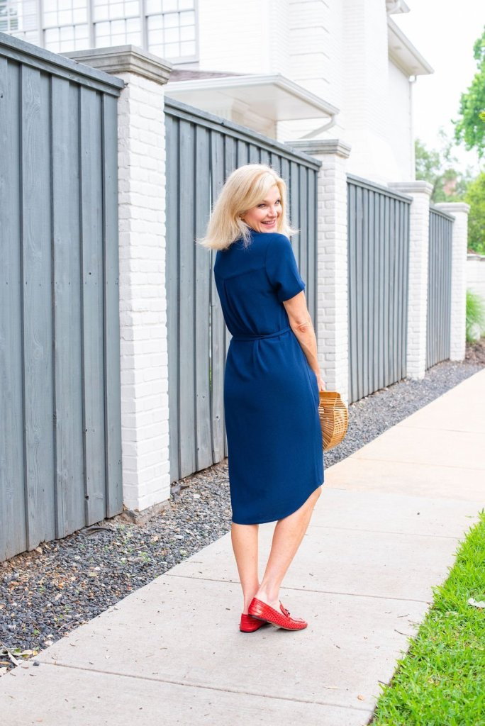 How to style cute shirt dresses in Summer featured by top US fashion blogger, Tanya Foster: image of a woman wearing a Rachel Parcell shirt dress, a Cult Gaia ark bag, and red Vince Camuto loafers.