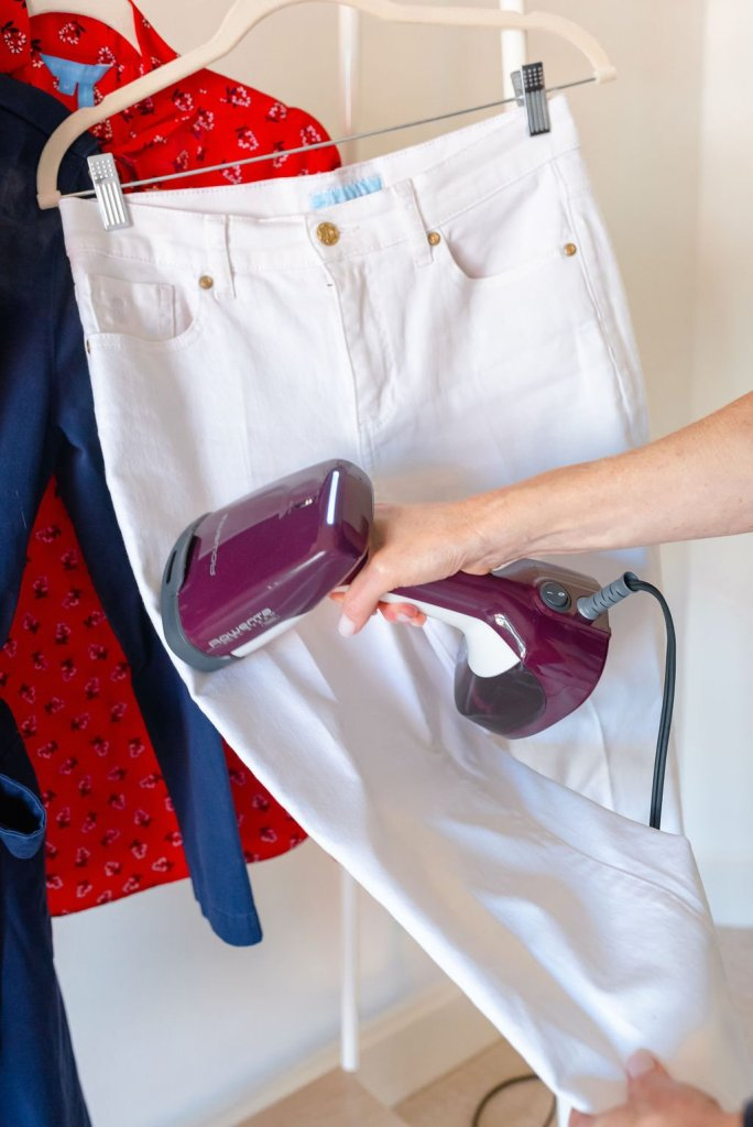 Using the Rowenta steamer to press white jeans