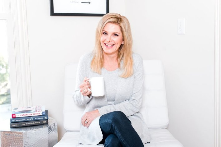 tanya foster sitting with a mug because she is a homebody
