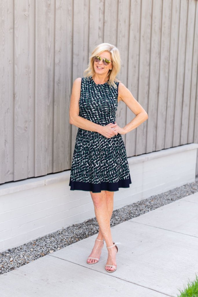 Eliza J Fit and Flare Dress | 5 Reasons to Love Eliza J Dresses by popular Dallas fashion blogger, Tanya Foster: image of a woman sitting outside and wearing an Eliza J Fit and Flare dress.