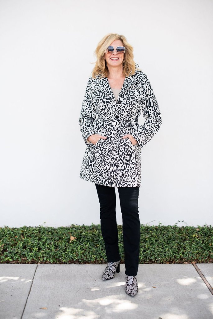 Chico's Animal Print collection for fall 2019 by popular Dallas fashion blogger, Tanya Foster: image of a woman wearing a Chico's CHEETAH-PRINT TRENCH RAIN COAT.