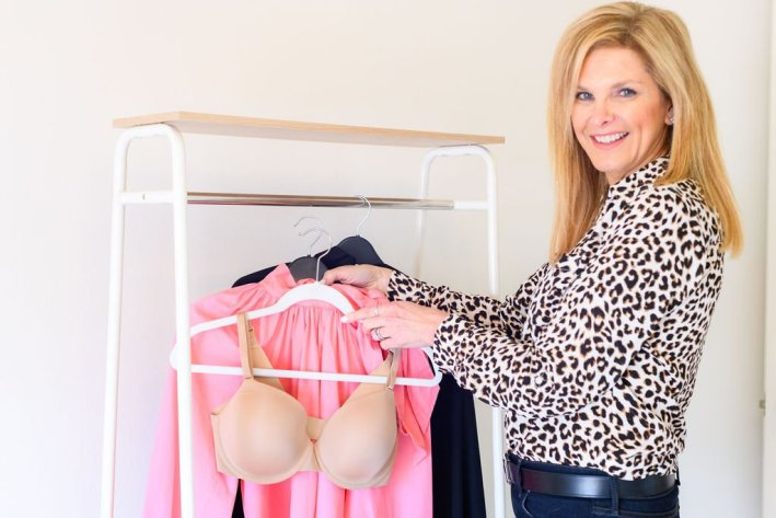 Tanya Foster holding the perfect bra soma vanishing 360 bra and wearing talbots animal print blouse