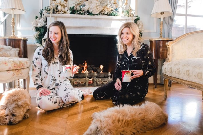 Tanya Foster and assistant sitting in front of a fireplace in Soma pajamas