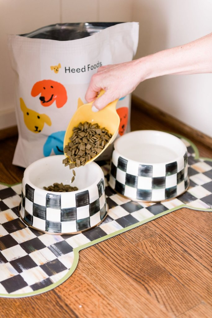 Tanya Foster pouring Heed Foods kibbles into Mackenzie-Childs dog bowls