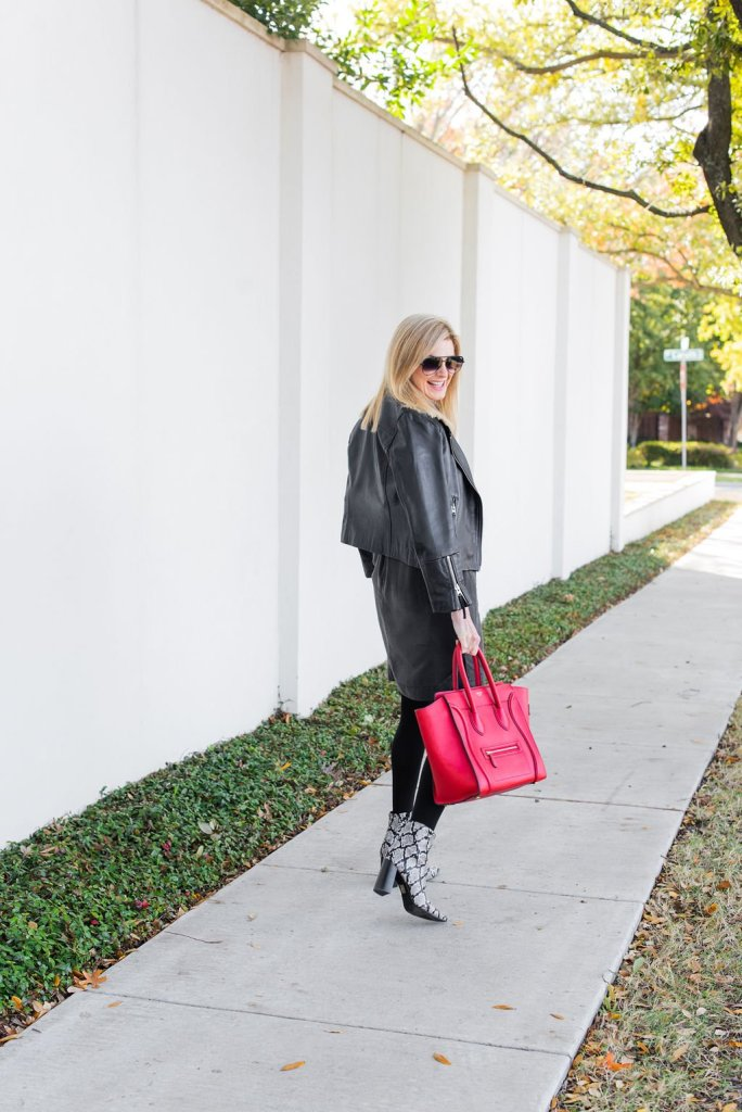 Tanya Foster walking down a sidewalk with a Celine red tote bag