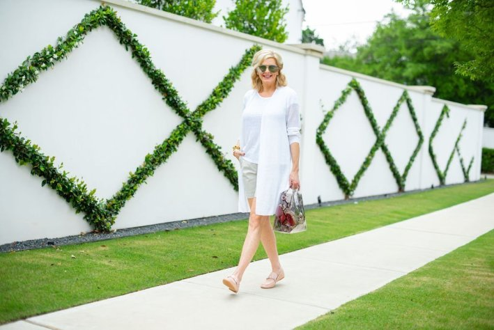 How to style flattering shorts, styling tips featured by top US fashion blogger, Tanya Foster: image of a woman wearing a Vince Camuto weekend tote, Quay Australia aviator sunglasses, Julie Vos Valencia bracelet, Talbots chino shorts, Talbots linen tee, and Vince Camuto loafers,