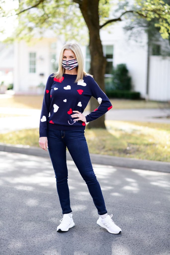Tanya foster wearing talbots heart sweater veronica beard jeans and adidas sneakers with talbots face mask