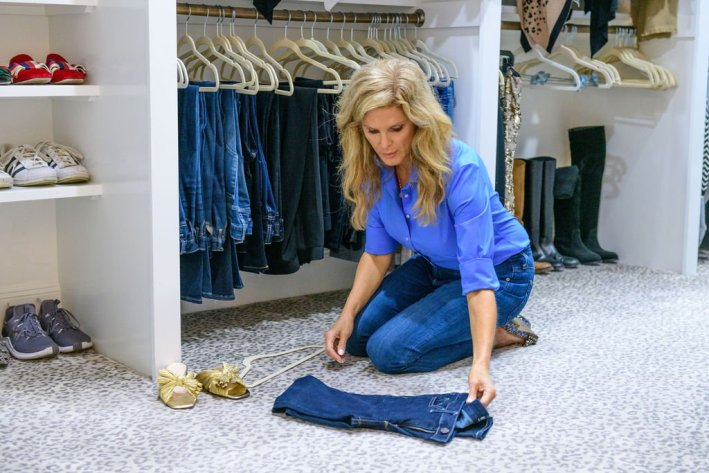 Tanya Foster folding a pair of jeans in a blue talbots shirt and jeans