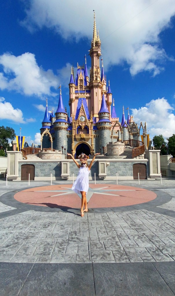 Tanya Foster in front of the Magic Kingdom castle