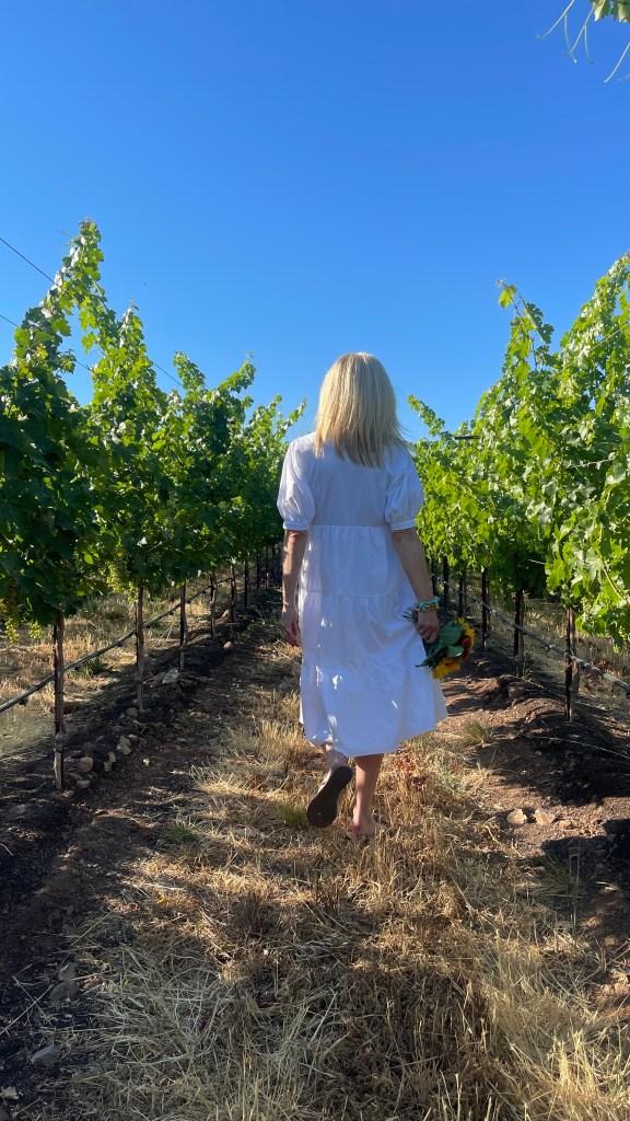 Tanya Foster walking in the Jordan Winery vineyard