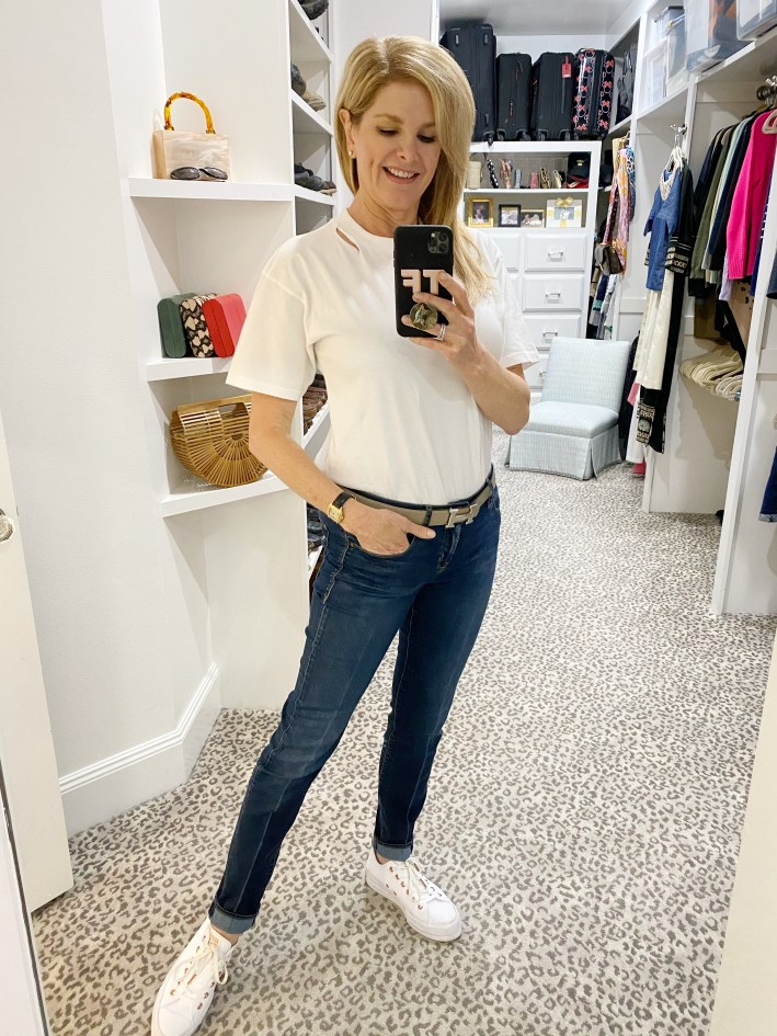 tanya foster in jeans hermes belt white tshirt and sneakers