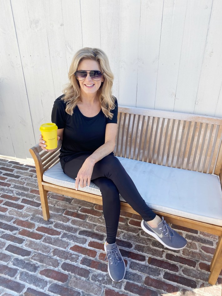 Tanya Foster sitting with coffee