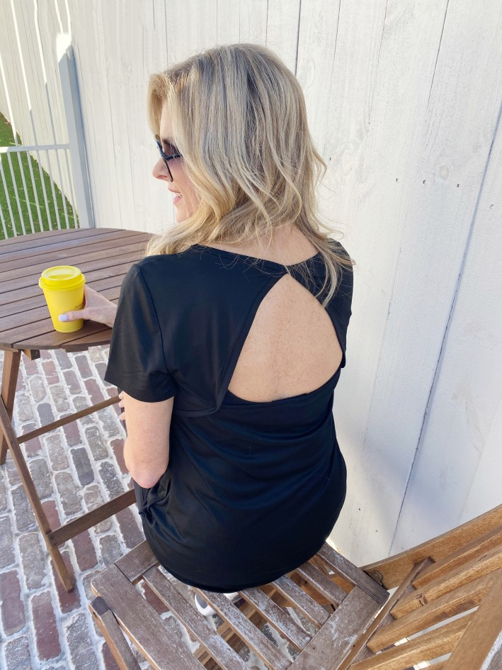 Tanya Foster sitting with coffee in Soma activewear