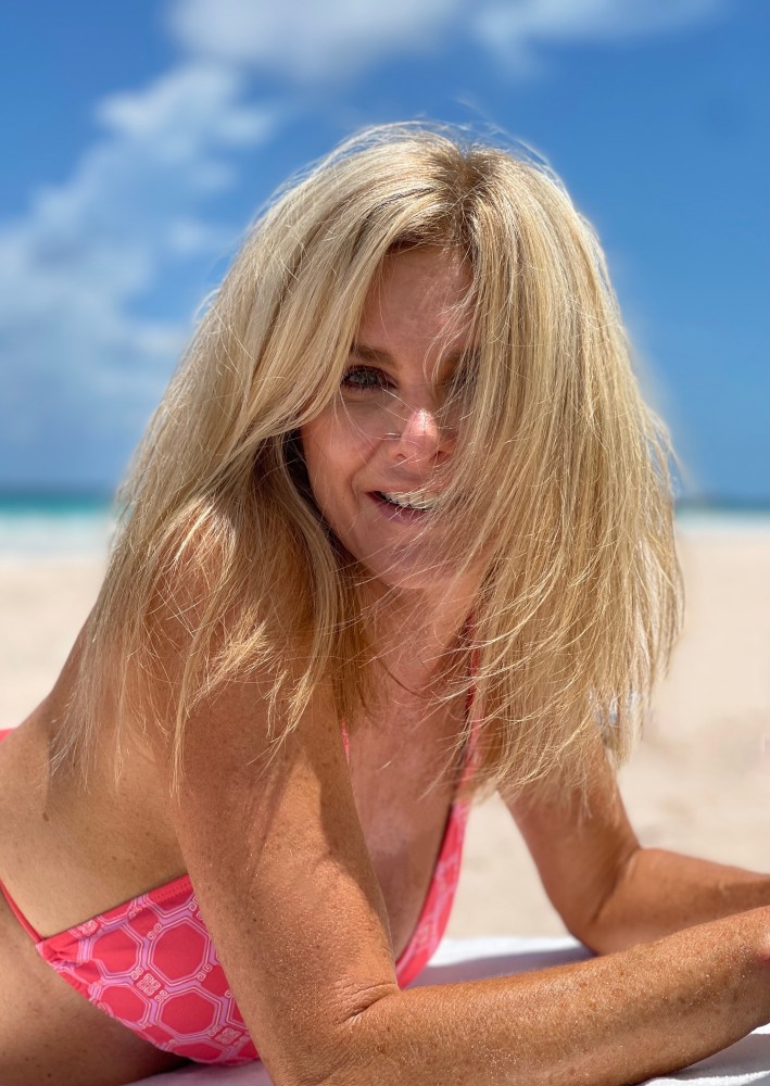 Tanya Foster on the beach in cabana life swimsuit